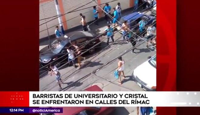 Barristas de Universitario y Sporting Cristal se enfrentaron a pedradas y balazos en el Rímac [VIDEO]