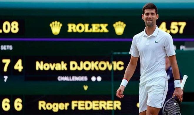 Novak Djokovic y su celebración tras salir campeón de Wimbledon 2019   Crédito: EFE