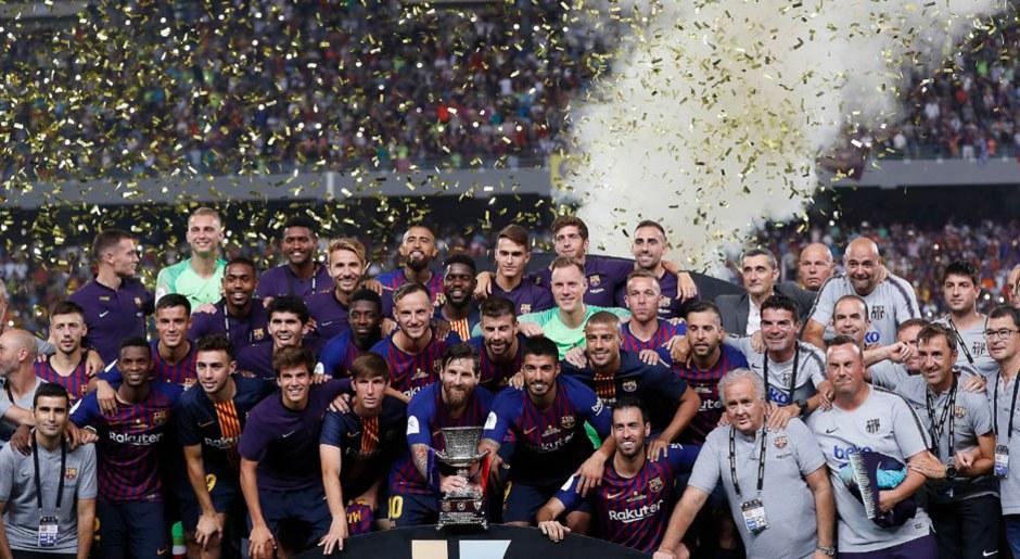 Foto: AFP. Las postales del título del Barcelona, con Lionel Messi, en la Supercopa de España tras ganar a Sevilla